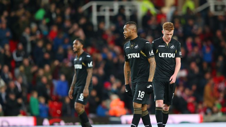 Swansea City players look dejected during their 2-1 defeat at Stoke City