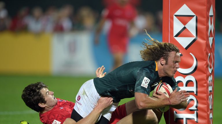 South Africa's Werner Kok crosses for a try against Canada