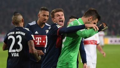 Sven Ulreich is congratulated by Thomas Muller after saving a 95th-minute penalty