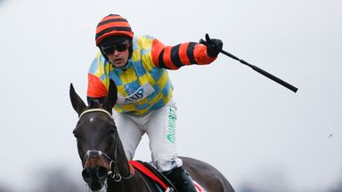 Nico de Boinville ridng Might Bite celebrates winning the 32Red King George VI Chase