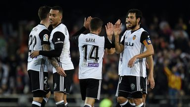 Valencia's players celebrate after their late winner