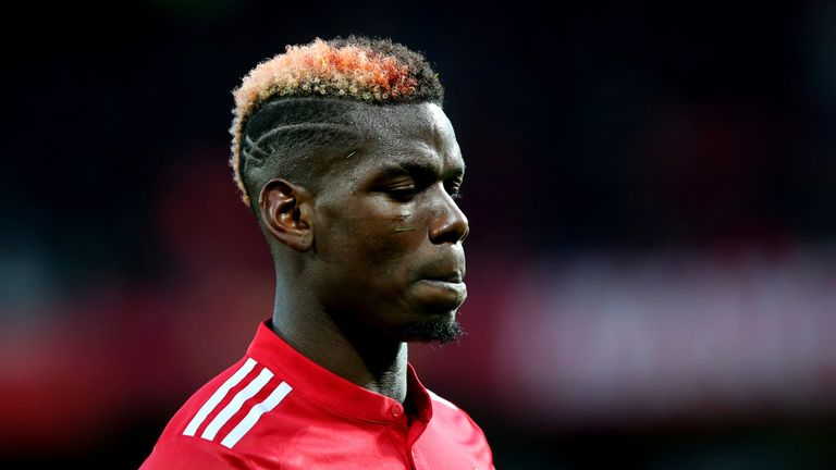 Paul Pogba looks on during the Premier League match between Manchester United and Brighton and Hove Albion at Old Trafford