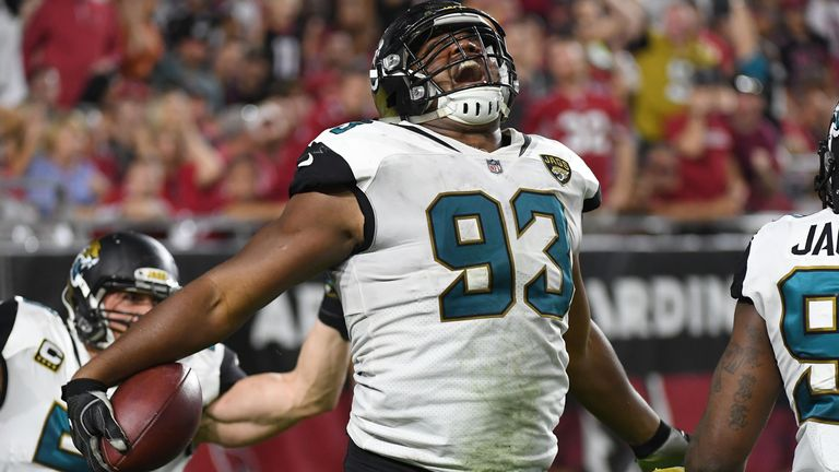 GLENDALE, AZ - NOVEMBER 26:  Calais Campbell #93 of the Jacksonville Jaguars celebrates a ten yard fumble recovery touchdown against the Arizona Cardinals