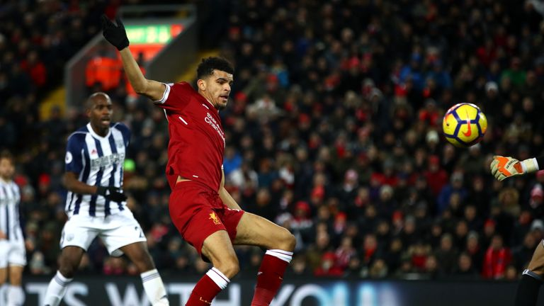 LIVERPOOL, ENGLAND - DECEMBER 13: Dominic Solanke of Liverpool shoots during the Premier League match between Liverpool and West Bromwich Albion at Anfield