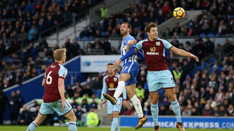 BRIGHTON, ENGLAND - DECEMBER 16: Glenn Murray of Brighton and Hove Albion wins a header over James Tarkowski of Burnley during the Premier League match bet