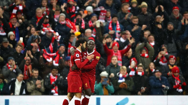 Mohamed Salah celebrates hisl goal with team-mate Sadio Mane