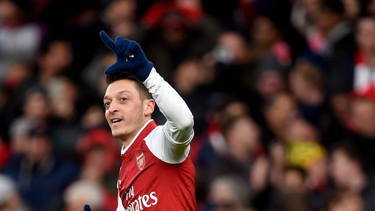 Arsenal's Mesut Ozil celebrates scoring his side's first goal of the game