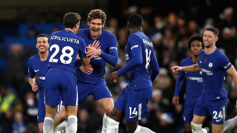 Marcos Alonso celebrates with team-mates after giving Chelsea a 1-0 lead