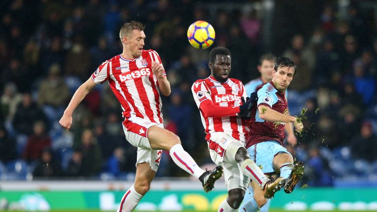 Jack Cork gets to the ball ahead Mame Biram Diouf and Darren Fletcher