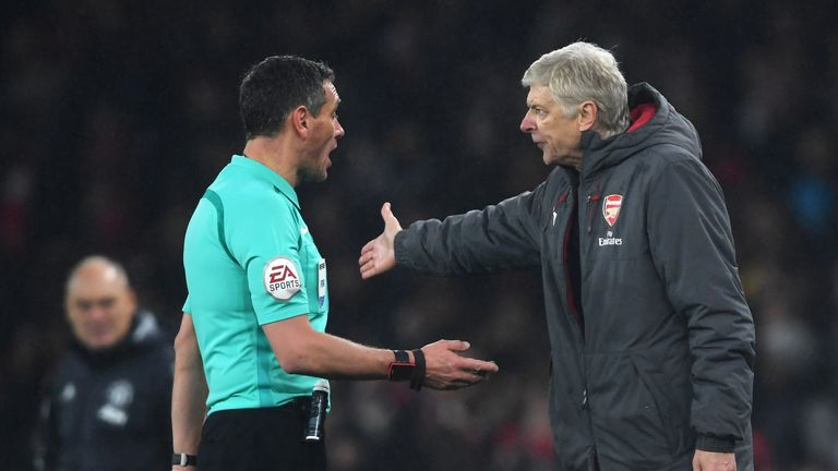 LONDON, ENGLAND - DECEMBER 02: Arsene Wenger, Manager of Arsenal argues with referee Andre Marriner after during the Premier League match between Arsenal a