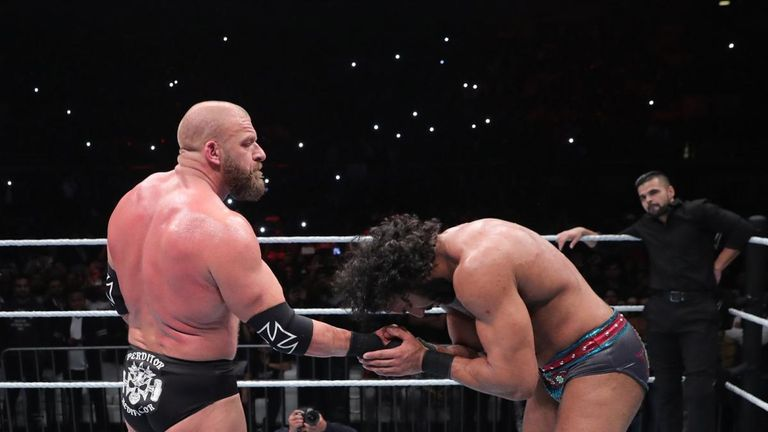 Triple H and Jinder Mahal shake hands after their match in New Delhi