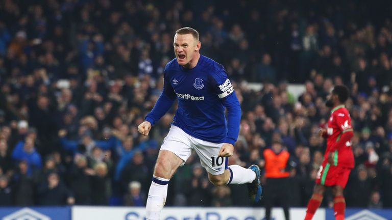 LIVERPOOL, ENGLAND - DECEMBER 18:  Wayne Rooney of Everton celebrates as he scores their third goal from the penalty spot during the Premier League match b