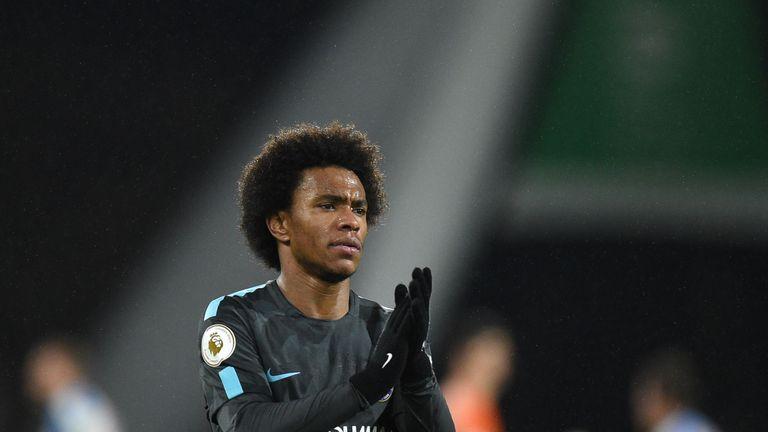 Chelsea's Brazilian midfielder Willian applauds fans after winning the English Premier League football match between Huddersfield Town and Chelsea at the J