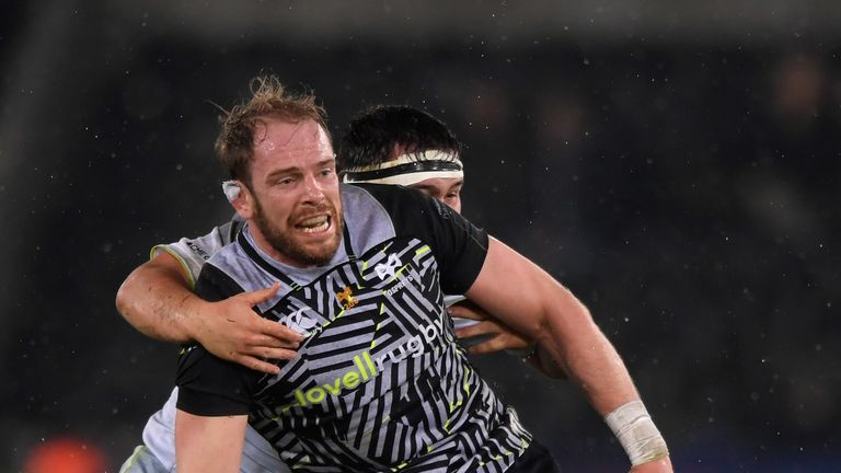 Alun Wyn Jones offloads in the tackle