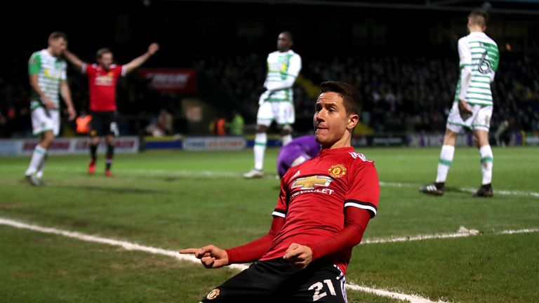 Ander Herrera celebrates scoring his side's second goal, assisted by Sanchez