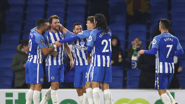 Dale Stephens is congratulated after scoring Brighton's first goal against Palace