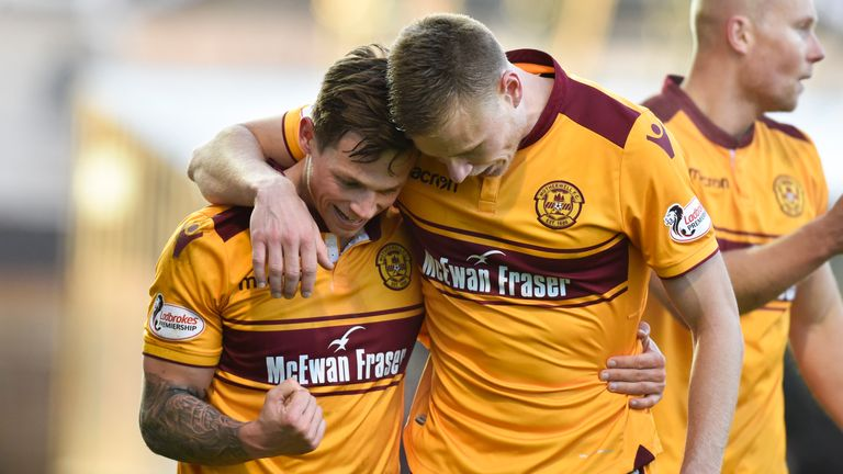 Motherwell's Craig Tanner (left) celebrates with his team-mates after scoring his side's second goal of the game