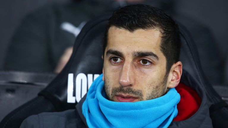 Henrikh Mkhitaryan takes his place on the bench ahead of the Premier League match between Swansea City and Arsenal at The Liberty Stadium