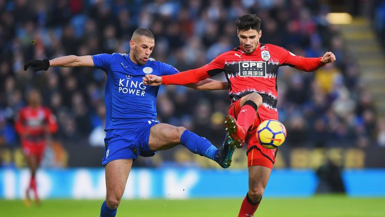 Islam Slimani challenges Christopher Schindler during the Premier League match