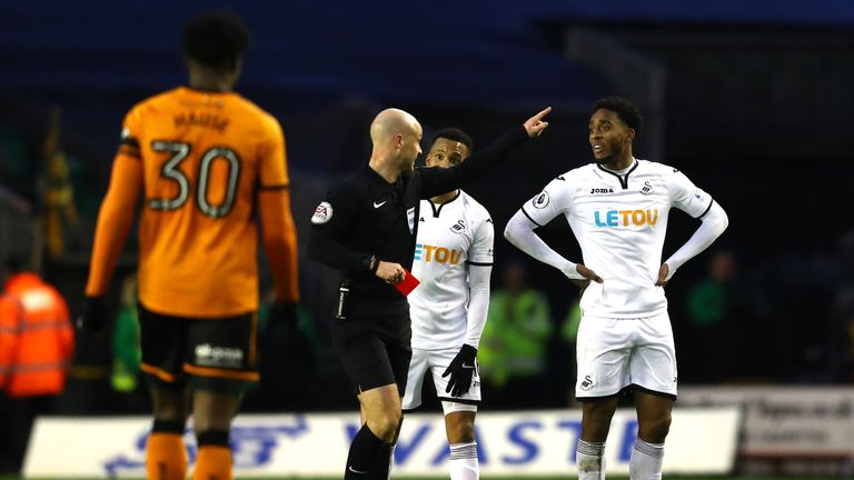 Leroy Fer of Swansea City gets a red card from referee, Anthony Taylor