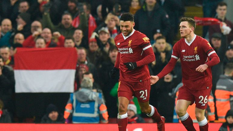 Alex Oxlade-Chamberlain celebrates giving Liverpool a ninth-minute lead