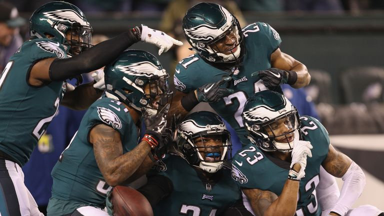 Corey Graham and the Eagles defense celebrate after a second interception in the game