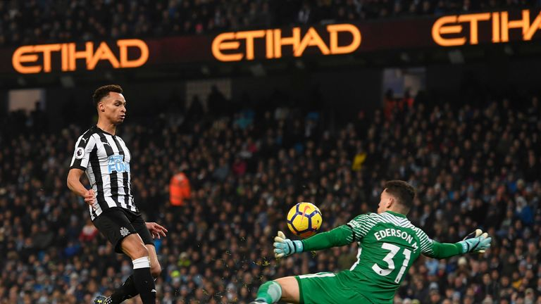 Jacob Murphy chips the ball over Ederson to pull a goal back for Newcastle United
