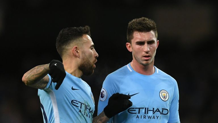 Club-record signing Aymeric Laporte (R) made his debut in defence alongside Nicolas Otamendi