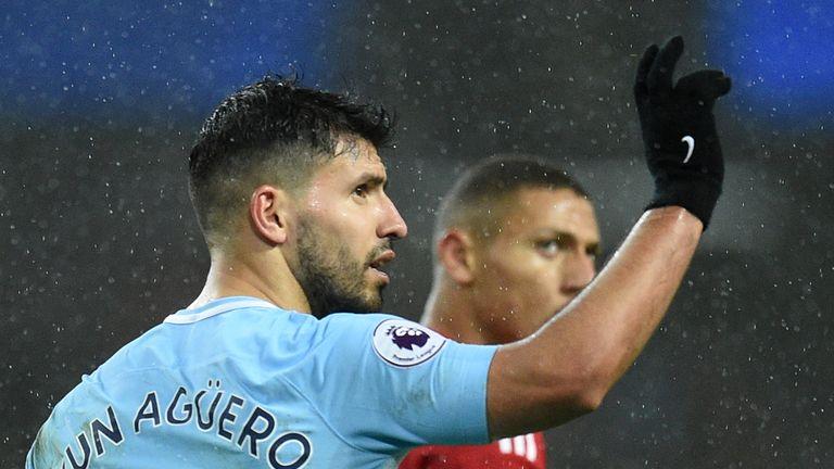 Sergio Aguero celebrates scoring Manchester City's third goal against Watford