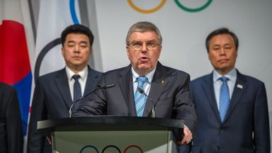 IOC President Thomas Bach confirms North Korea's participation at next month's Winter Olympic Games in Pyeongchang - flanked by officials from North and South Korea