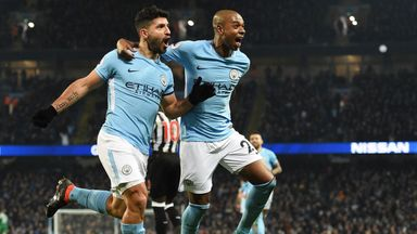 Man City striker Sergio Aguero (left) celebrates completing his hat-trick against Newcastle