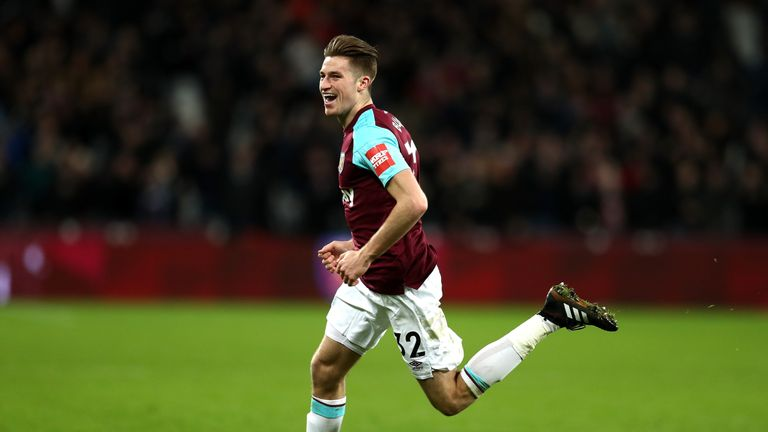 Reece Burke celebrates after breaking the deadlock in extra time at Lond Stadium