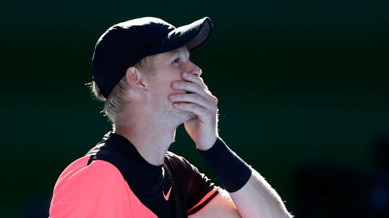 Kyle Edmund of Great Britain waits for the offical review prior to winning match point in his quarter-final match