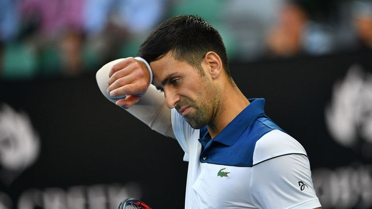 Serbia's Novak Djokovic reacts after a point against South Korea's Hyeon Chung during their men's singles fourth round match at the Australian Open