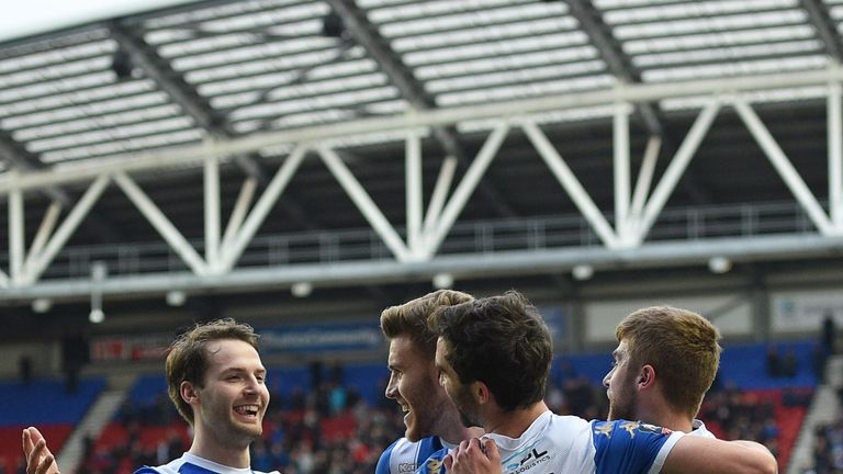 Will Grigg celebrates with team-mates