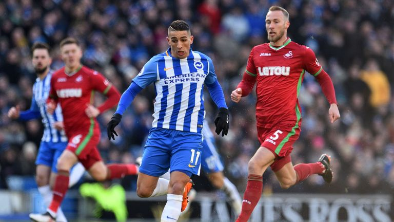 Brighton winger Anthony Knockaert (centre) takes on the Swansea defence