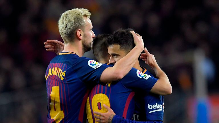 Philippe Coutinho is congratulated after extending Barca's lead against their neighbours
