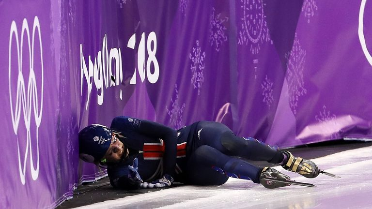 Elise Christie falls after a collision with Jinyu Li of China