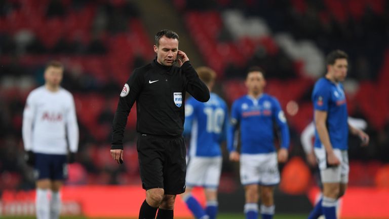Referee Paul Tierney consulted VAR before disallowing a goal from Eric Lamela during the FA Cup replay between Tottenham and Rochdale