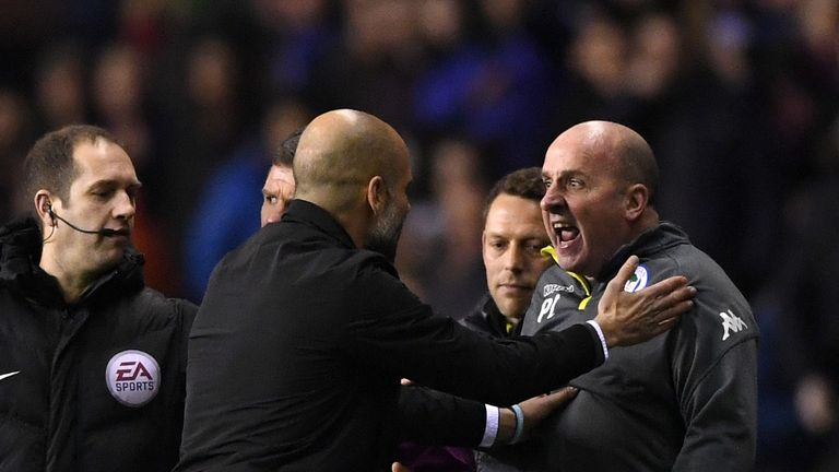 Pep Guardiola clashed with Wigan boss Paul Cook late in the first half