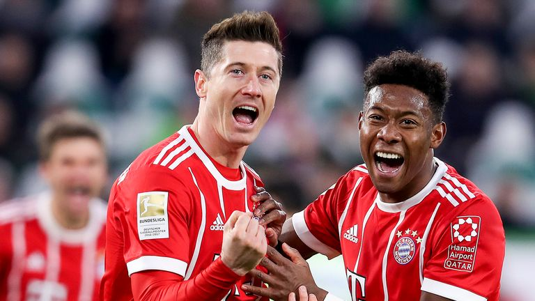 Robert Lewandowski and David Alaba celebrate the late winner