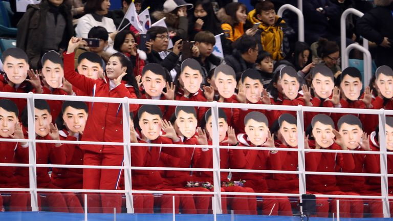 North Korean cheerleaders sing during the women's ice hockey preliminary round - Group B game