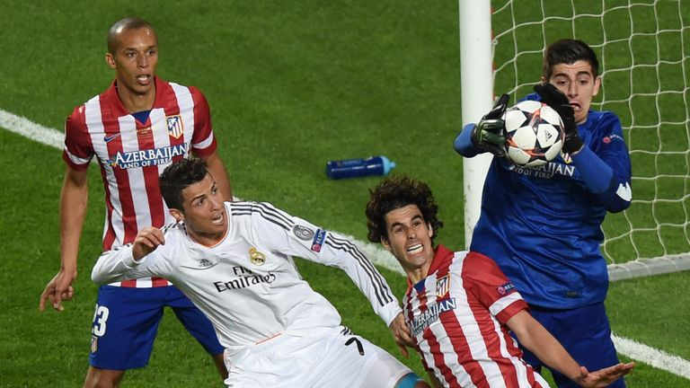 Courtois in action for Atletico Madrid against Real
