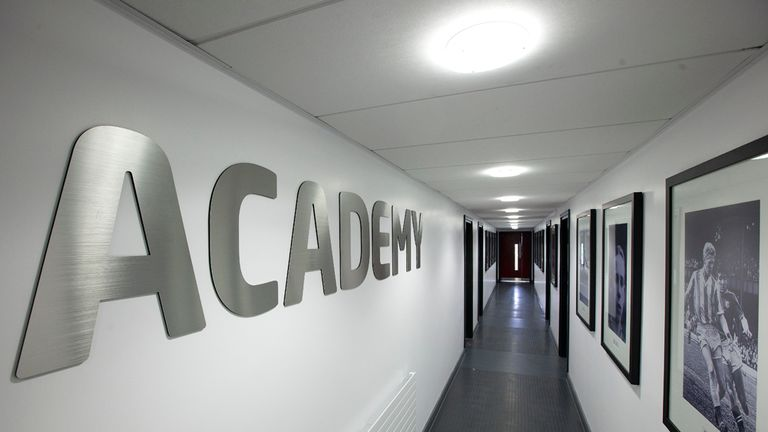Images of youth team graduates adorn the academy walls [Credit: Phil Greig]