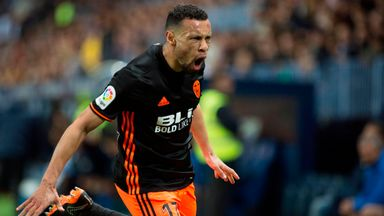 Valencia's midfielder Francis Coquelin celebrates scoring the equaliser against Malaga