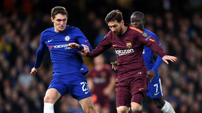 Lionel Messi of Barcelona runs with the ball under pressure from Andreas Christensen of Chelsea during the UEFA Champions League tie