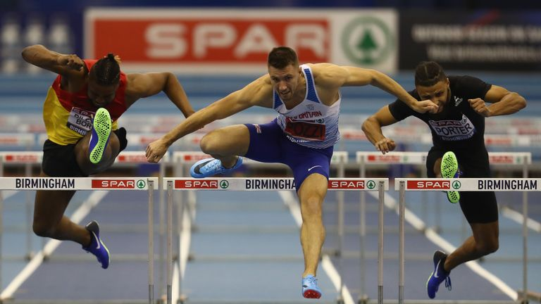 Andrew Pozzi (centre) storms to victory at the GB Indoor Championships in Birmingham