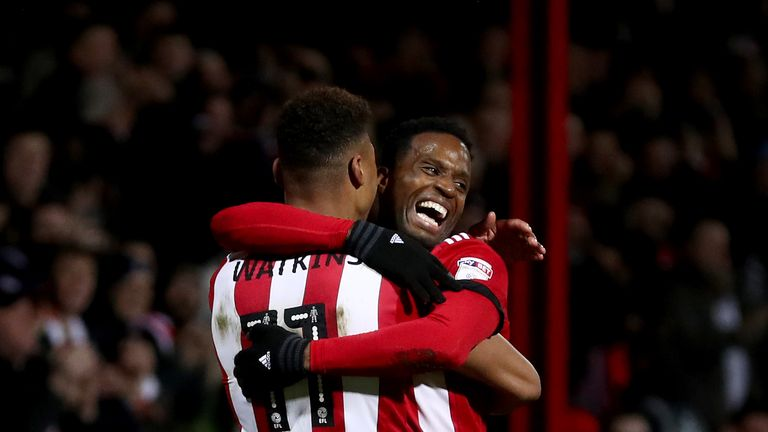 BRENTFORD, ENGLAND - FEBRUARY 20:  Ollie Watkins of Brentford celebrates with teammate Florian Jozefzoon after scoring the first Brentford goal during the