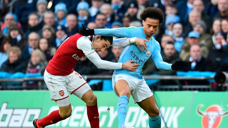 Leroy Sane vies for possession with Hector Bellerin during the Carabao Cup final