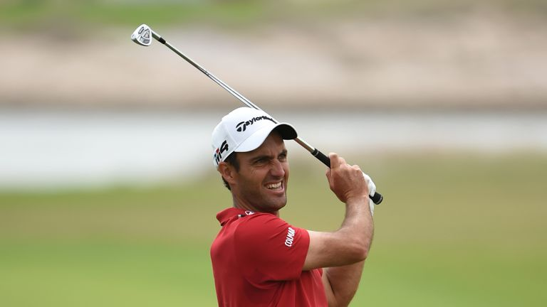 DOHA, QATAR - FEBRUARY 22:  Edoardo Molinari of Italy hits an approach shot on the 14th hole during the first round of the Commercial Bank Qatar Masters at